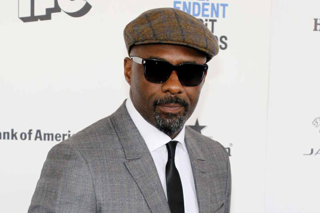 The Secret to Why Idris Elba Can Wear Any Suit f52ca8f0bcf
